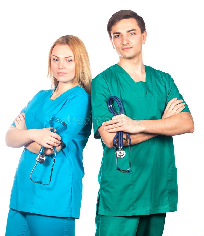 Здравоохранение и медицинская концепция - 2 доктора с стетоскопами стоковые фото