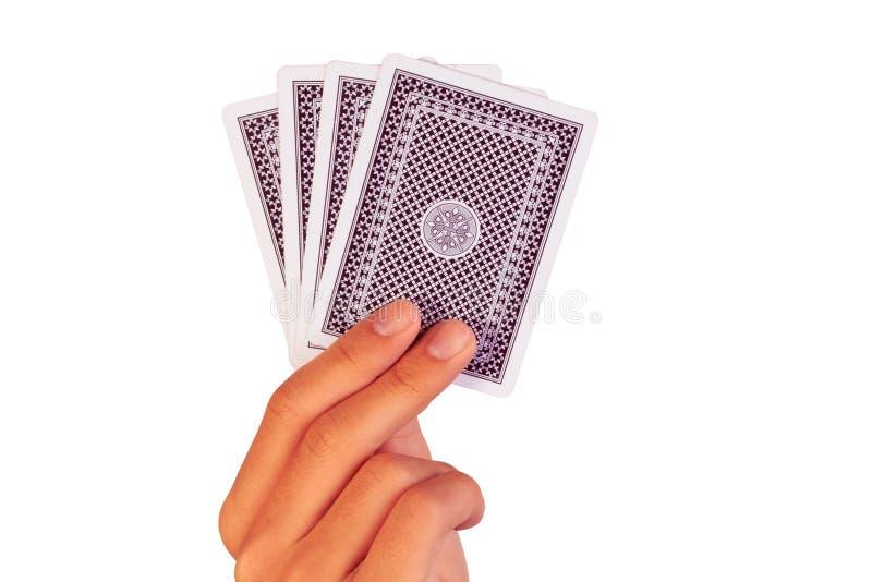 Играя карточки в руке изолированной на белизне стоковая фотография