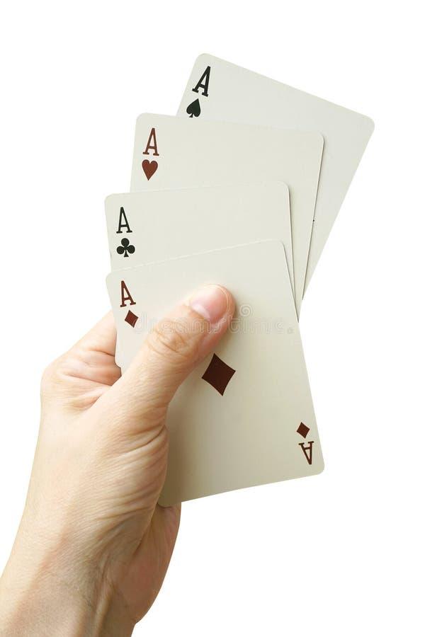 Играя карточки в руке изолированной на белой предпосылке стоковые изображения