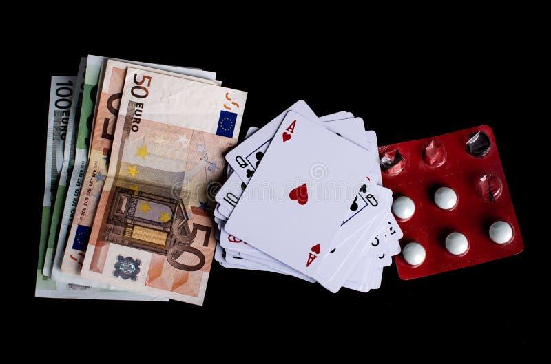 Игра, деньги и пилюльки стоковое изображение