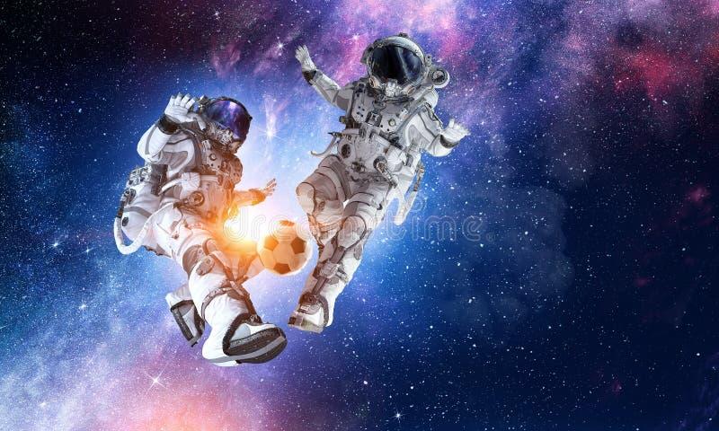 Игра футбола игры астронавта стоковые изображения rf