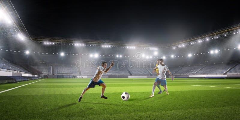 Игра футбола в действии стоковое изображение
