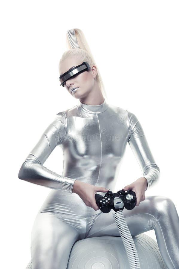 игра cyber играя видео- женщину стоковое изображение