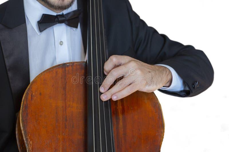 Игрока виолончели классической музыки проведение профессионального сольное, руки закрывает вверх стоковое изображение rf