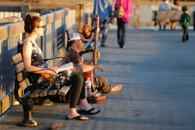 Игрок банджо на променаде стоковые фото