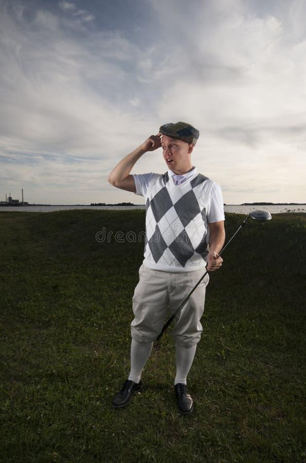 игрок в гольф шарика его смотреть стоковая фотография