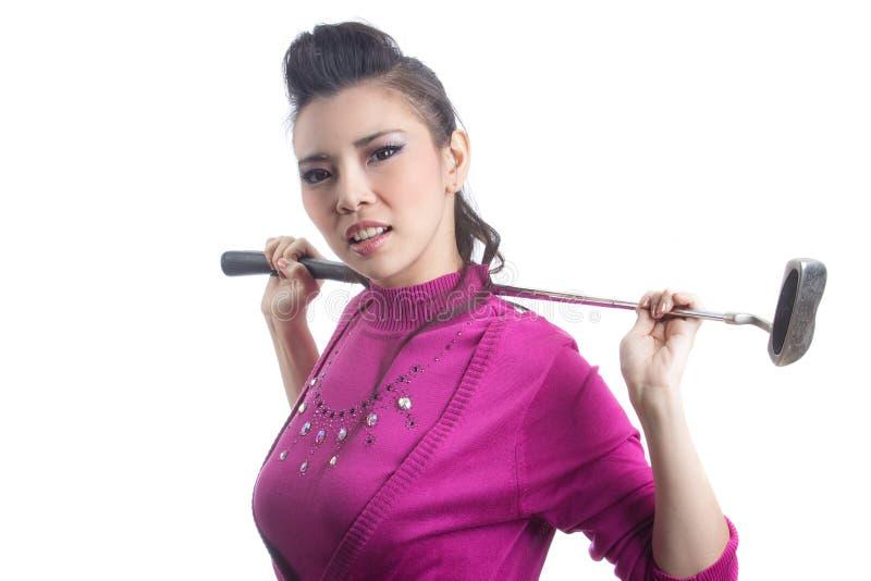 Игрок в гольф довольно молодой дамы стоковая фотография rf