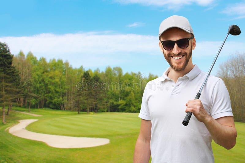 Игрок в гольф с гольф-клубом стоковые изображения rf