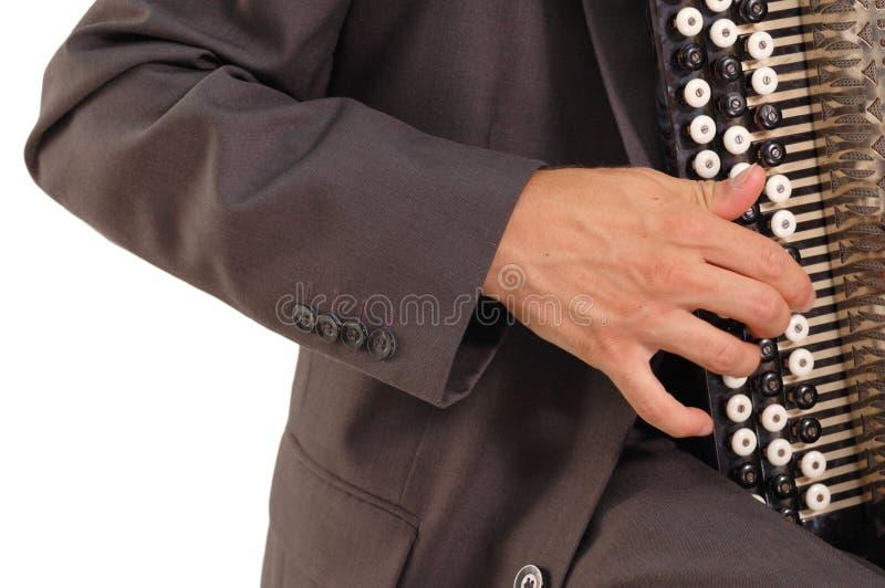 игрок руки кнопки аккордеони стоковая фотография rf
