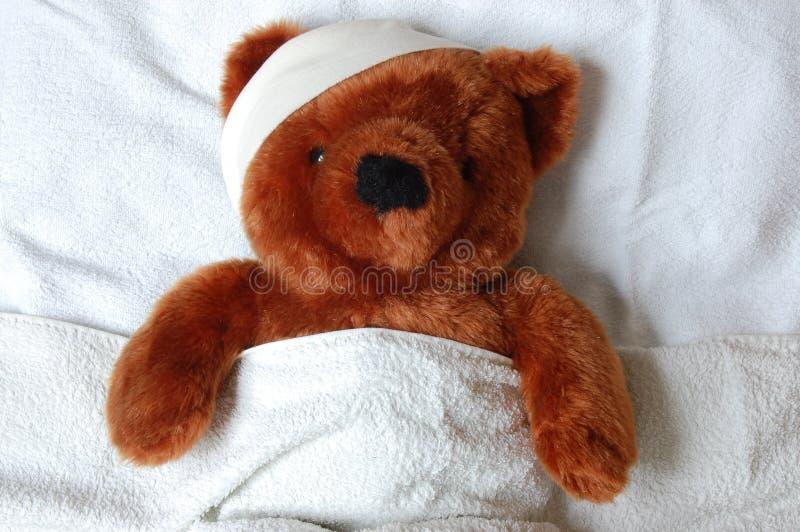 игрушечный больноя ушиба кровати стоковые изображения