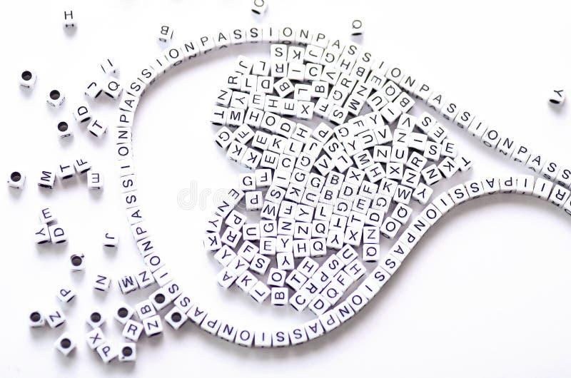Игрушка алфавита с страстью слова в ей стоковое изображение rf