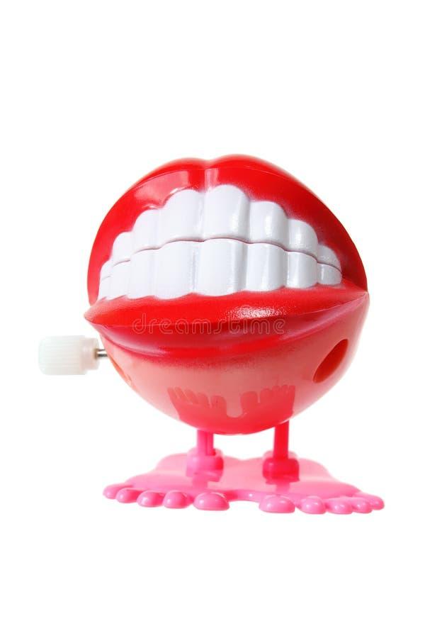 Игрушка зубов тараторить стоковое фото