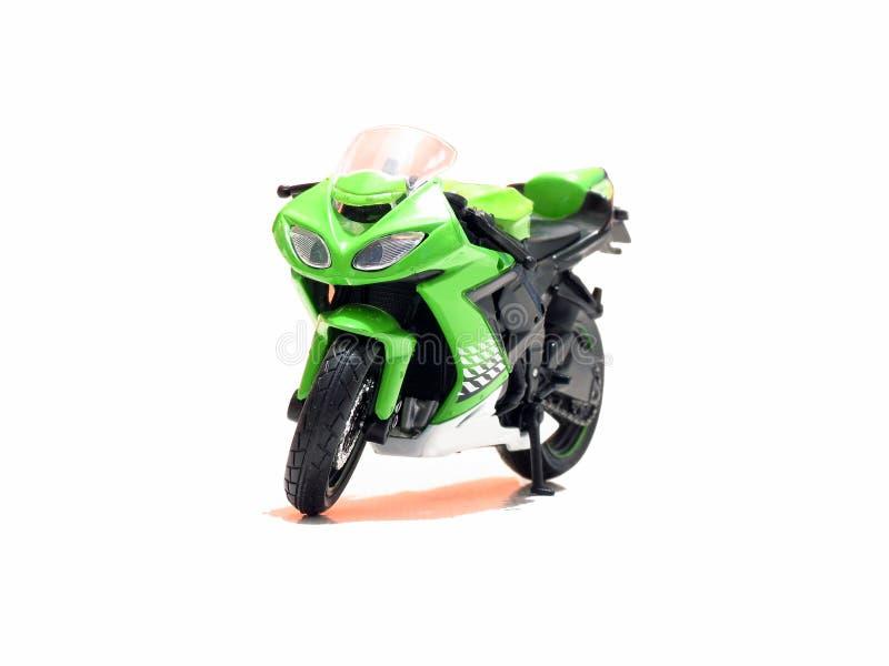 Игрушка мотоцикла спорт, припаркованная на прозрачной предпосылке 4 стоковая фотография rf