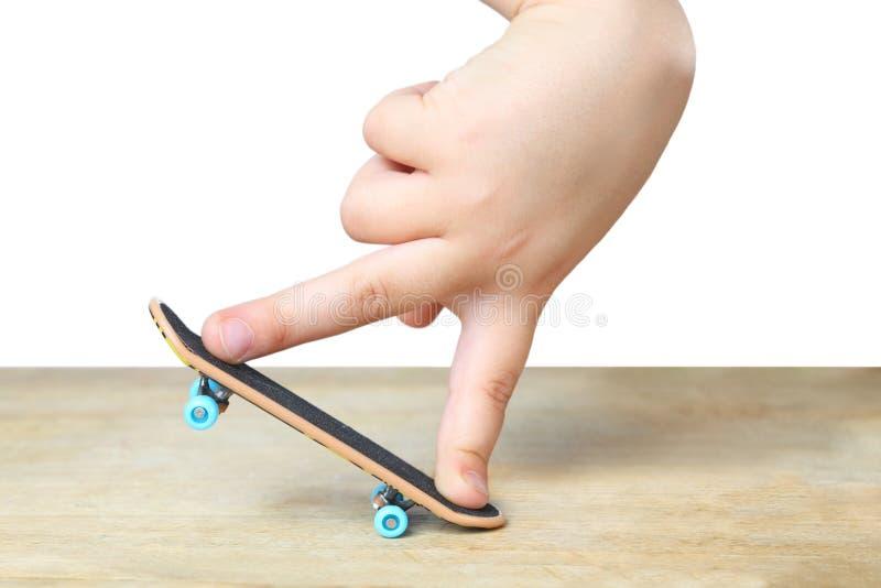 игрушка принципиальной схемы skateboarding стоковое фото