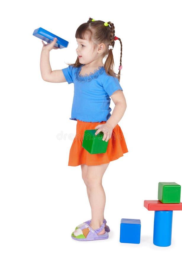 игрушки изолированные девушкой маленькие играя белые стоковая фотография rf