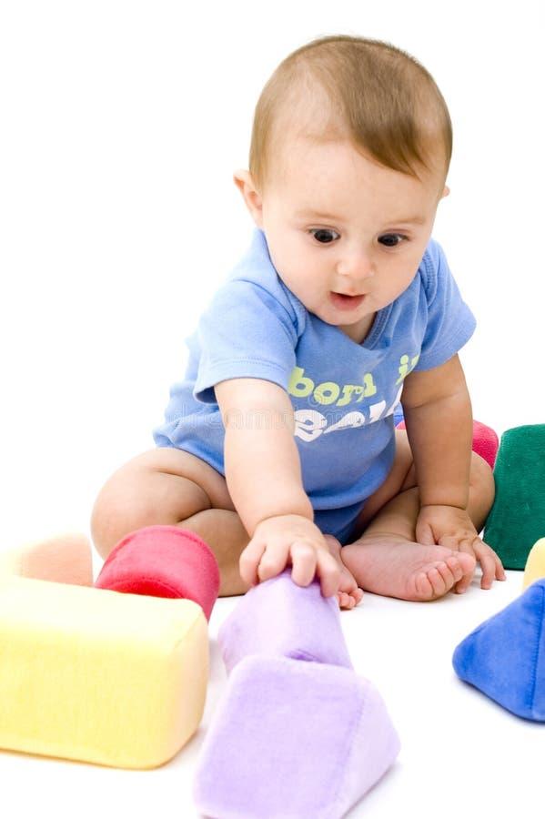 игрушки младенца милые играя стоковые изображения rf