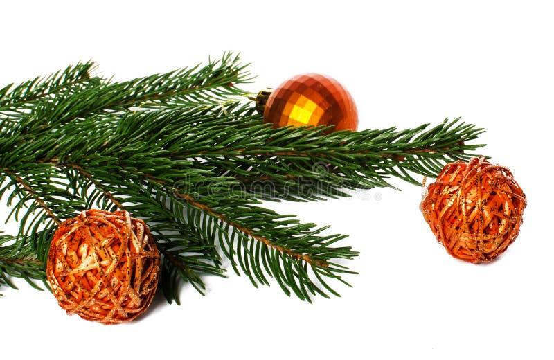 Игрушки рождества и ветвь рождественской елки стоковое фото