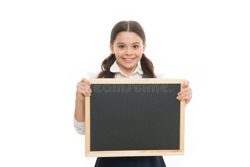 Идеальная школьница Счастливая школьная форма носки девушки r Волосы зрачка школьницы усмехаясь длинные Старательный стоковые фото