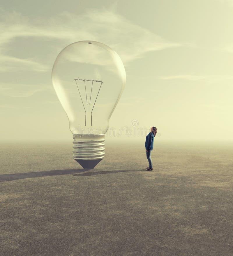 Идея электрической лампочки стоковые фото