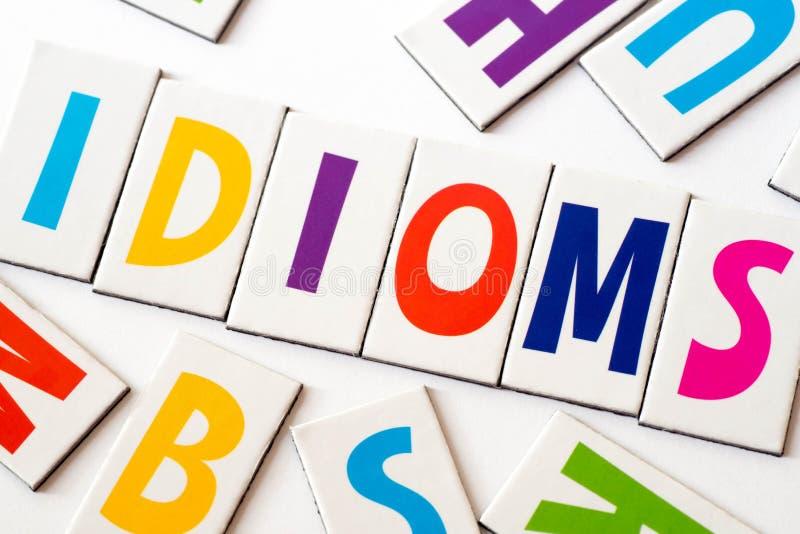 Идиоматизмы слова сделанные красочных писем стоковое изображение rf