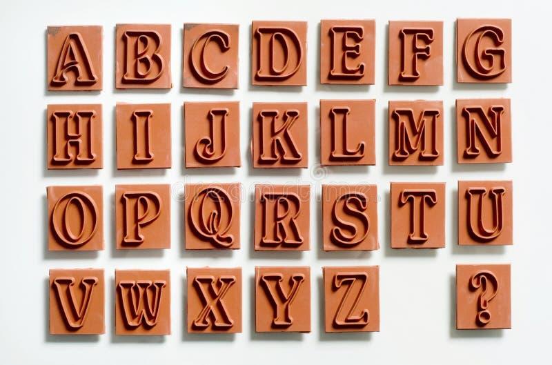 избитые фразы алфавита стоковые изображения