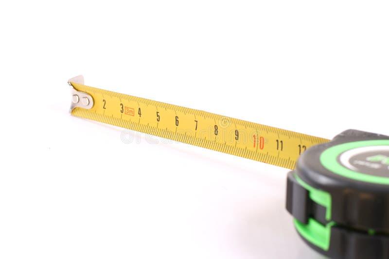 измерение длины над белизной инструмента стоковое фото rf
