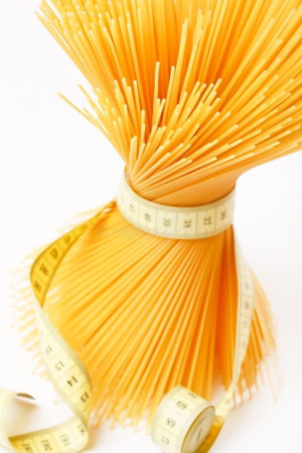 измеряя лента спагетти стоковые изображения
