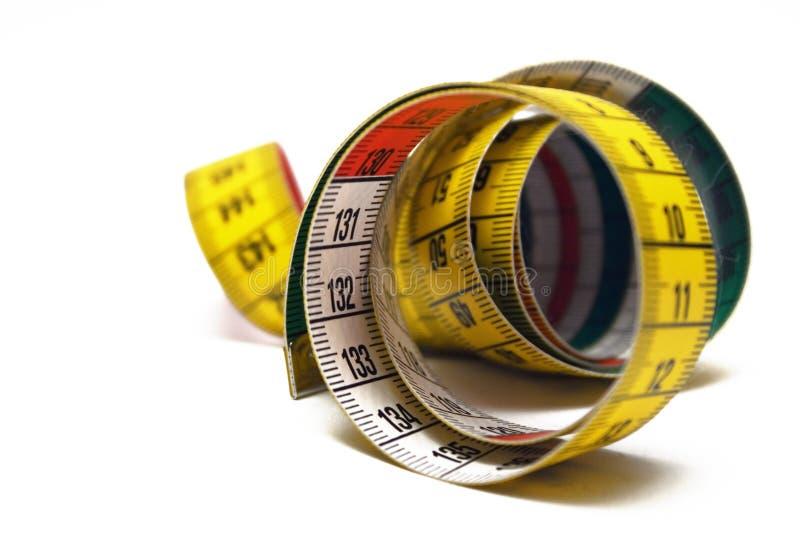 измеряя свернутая лента Стоковые Фотографии RF