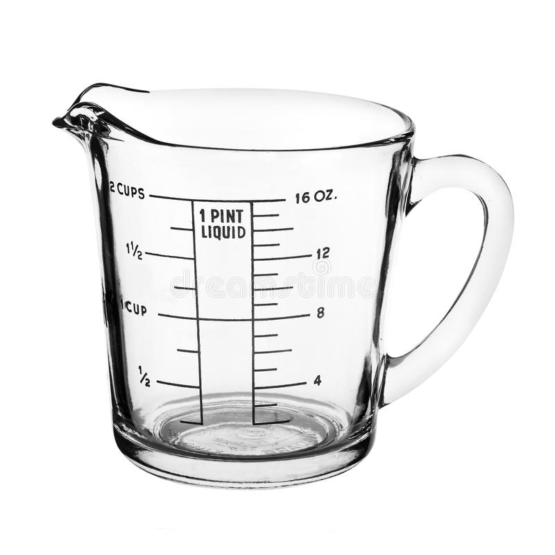 Измеряя чашка изолированная на белой предпосылке стоковые изображения