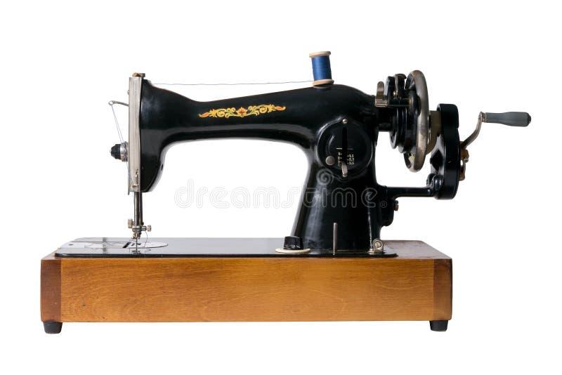 Изображение винтажной советской швейной машины изолированной на белом backgro стоковые фото
