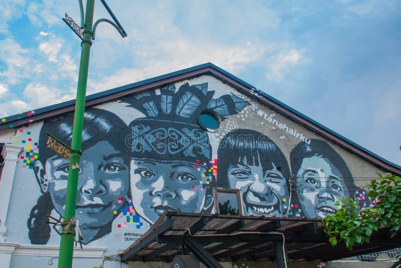 Изображение детей Дом на улице покрасил цвета, пестротканые граффити Kuching sarawak граничат Малайзия стоковое изображение rf