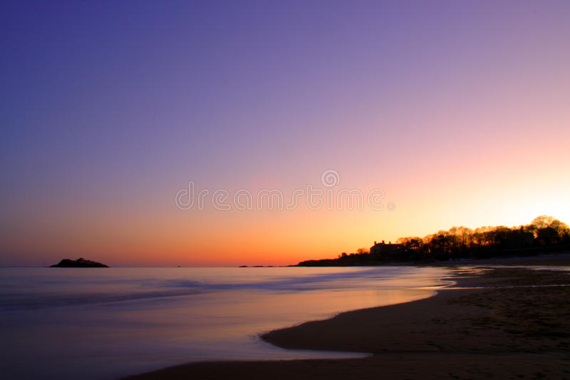 Изображение запаса захода солнца пляжа петь стоковое изображение