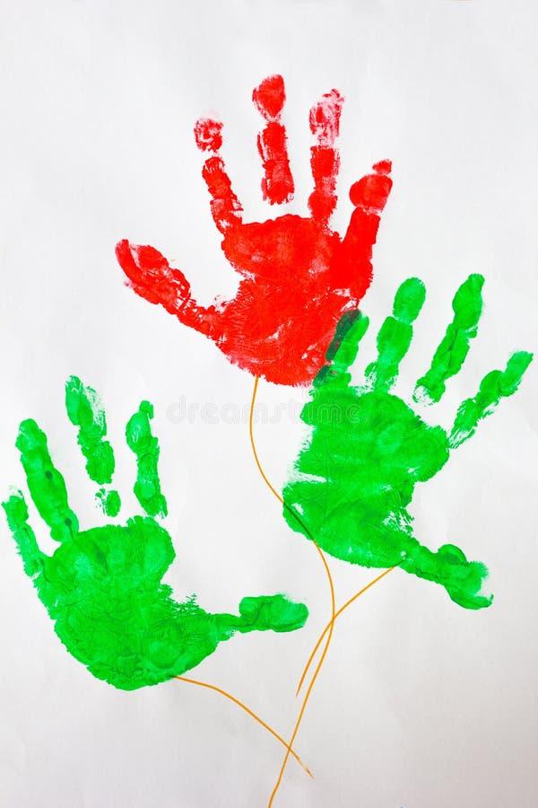 Изображение красочных рук детей печати на белизне стоковая фотография rf