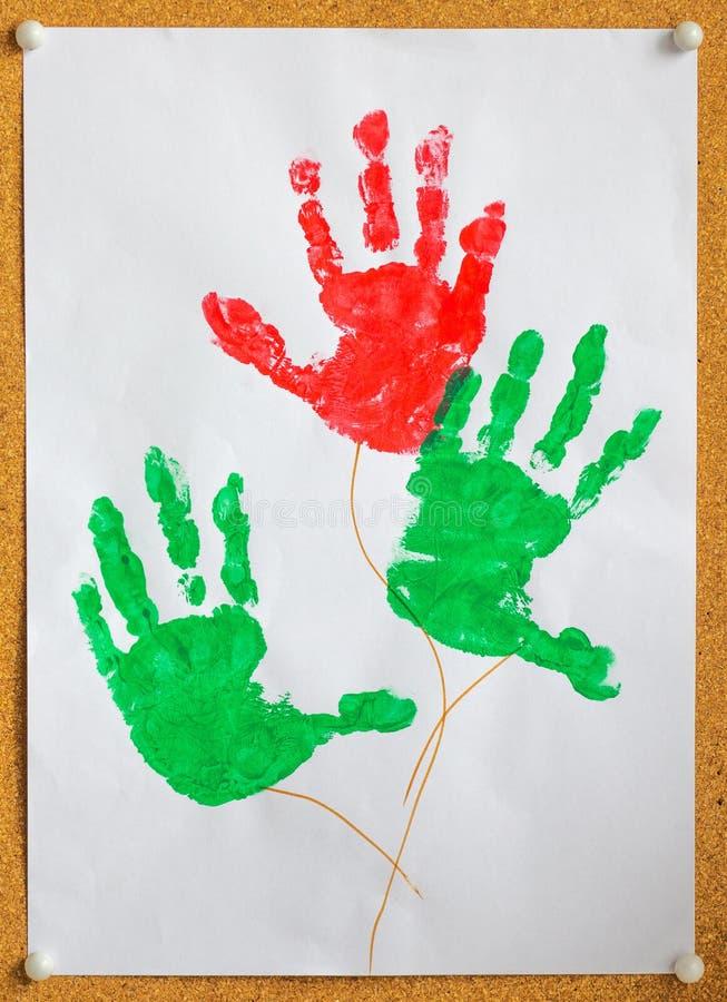 Изображение красочных рук детей печати на белизне стоковая фотография