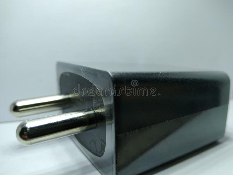 Изображение переходника заряжателя на белой предпосылке, стоковые изображения rf