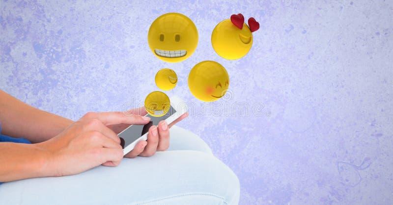 Изображение произведенное цифров emojis летая над руками используя умный телефон бесплатная иллюстрация