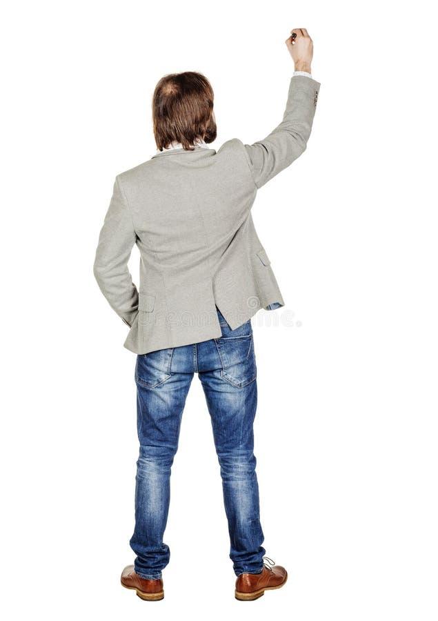 Изображение тела заднего или заднего взгляда полное сочинительства человека что-то дальше стоковая фотография rf