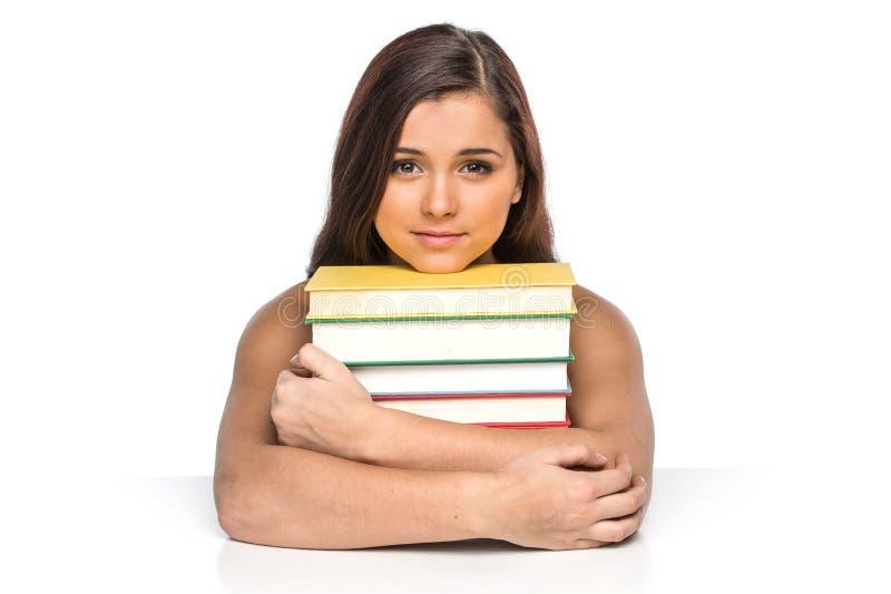 Изображение усмехаясь студента с стогом книг стоковые фотографии rf
