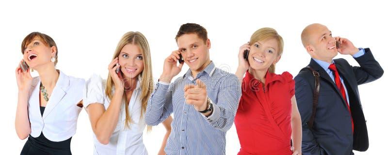 Изображение человека и женщины с сотовыми телефонами стоковое фото rf