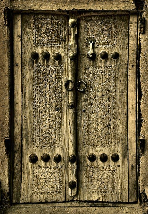 Изображение Close-up стародедовских дверей стоковая фотография