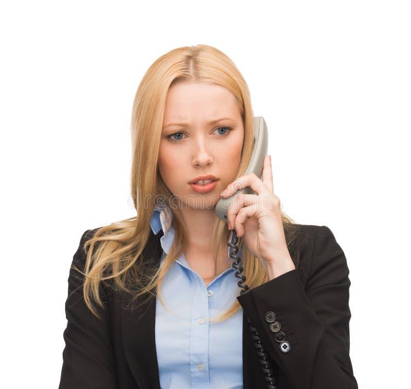 Изображение confused женщины с телефоном стоковое фото rf