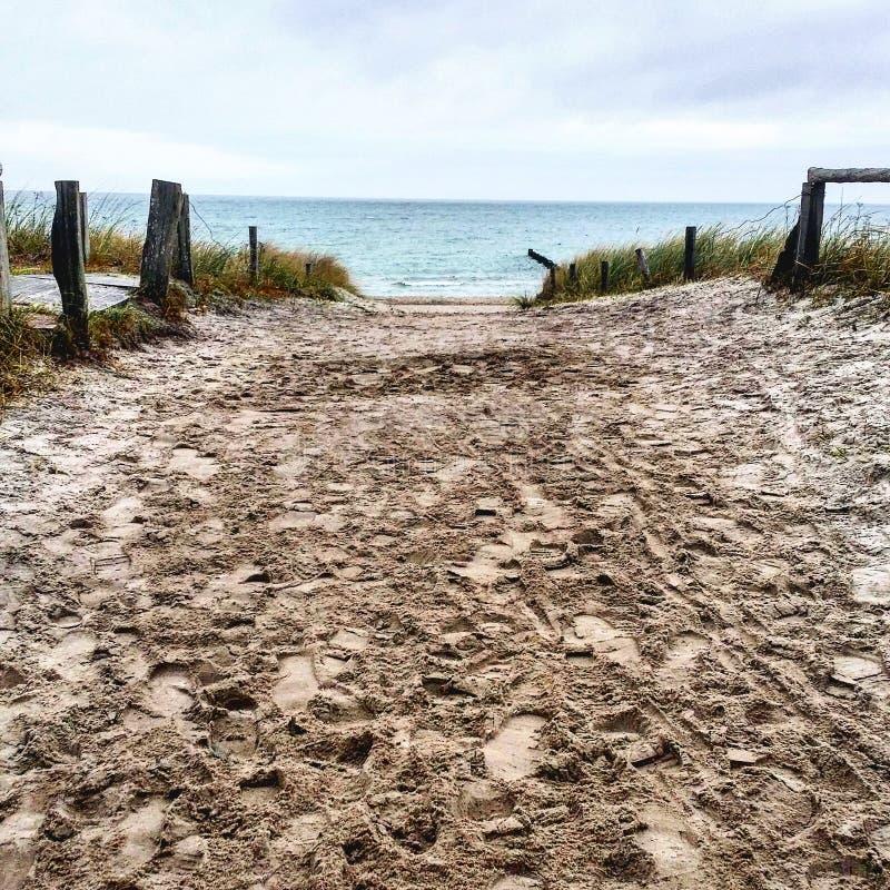Изображение Eastsea с песком и водой стоковая фотография