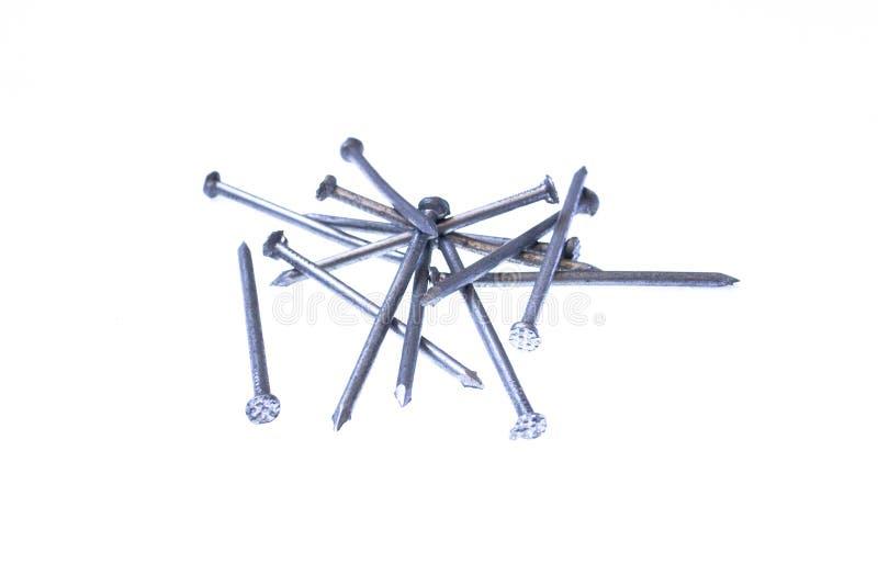 изолированная белизна кучи ногтей стоковая фотография