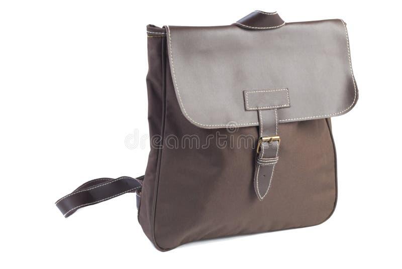 изолированная женщина backpack коричневая стоковая фотография