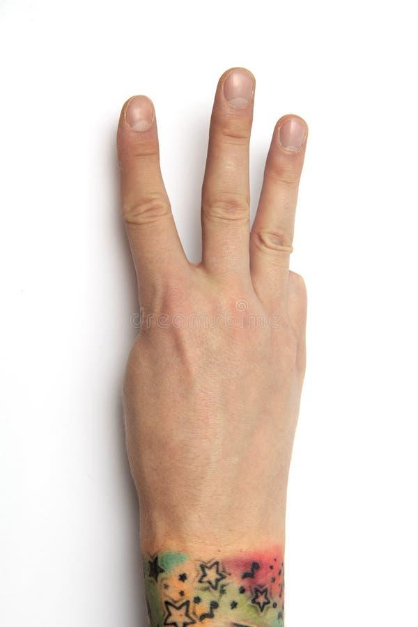 Изолированная рука показывает 3 Рука указывая вверх по 3 пальцам 3 стоковые фото