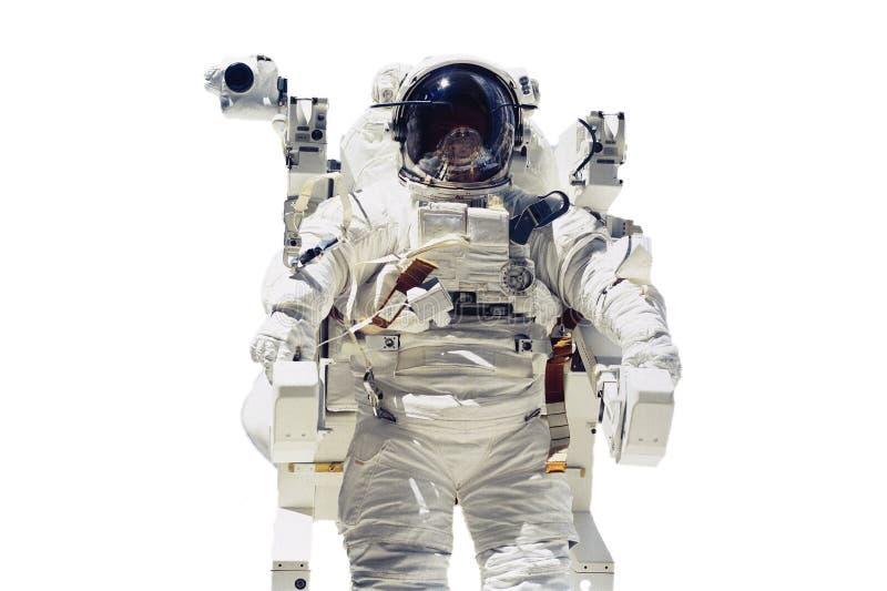 Изолированное летание астронавта в космосе Элементы этого изображения обеспечили NASA f стоковое фото