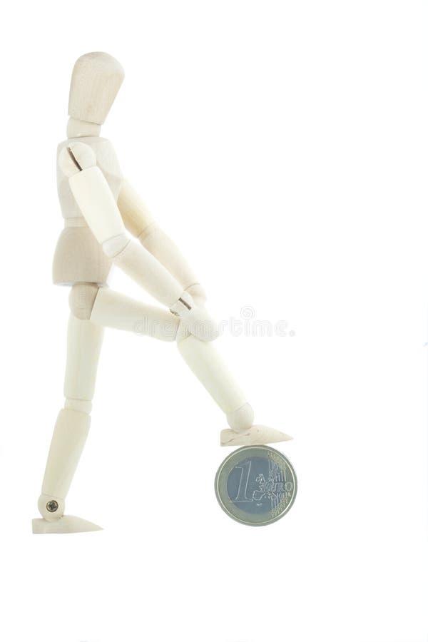 изолированное монеткой положение manikin стоковое фото rf