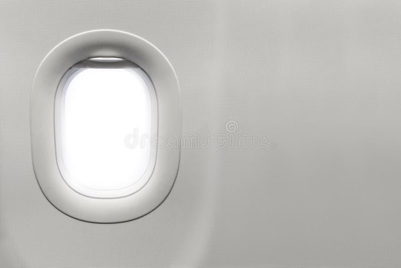 Изолированное окно самолета стоковое фото