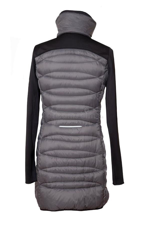 Изолированное пальто женщины Изолированное пальто спуска стильных женщин серое теплое стоковое фото rf