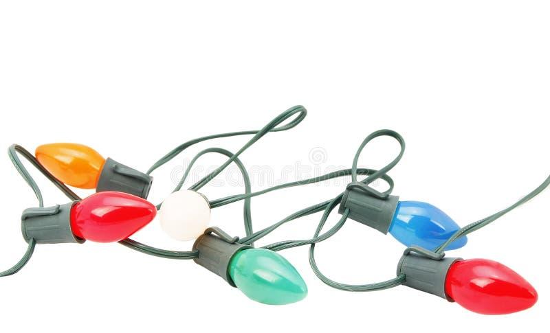 изолированное рождество освещает шнур стоковое фото